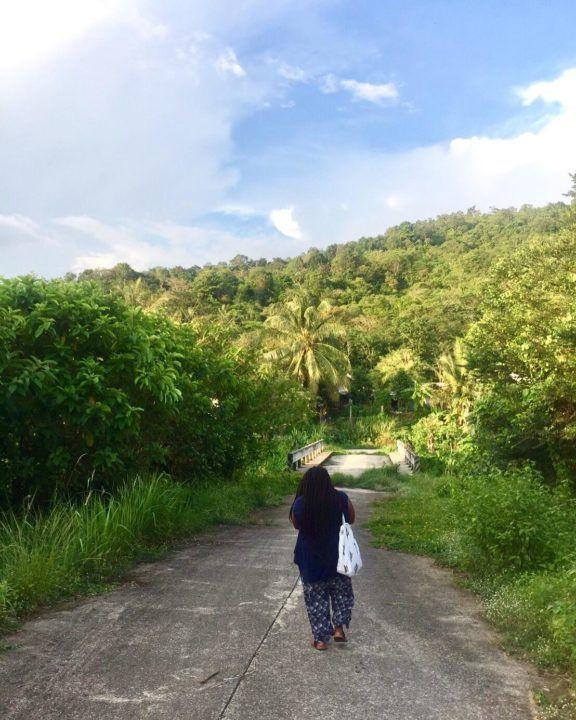 Didi taking a stroll down a quiet road in Ranong, Thailand