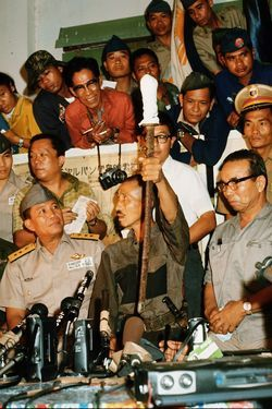 Hiroo Onoda holds up the samurai sword that he kept with him during his years in the jungles of the Phillippines. He was sent to the Philippines late in 1944 to lead guerrilla warfare tactics against the Allied forces. After the unit was defeated by the U.S. military, a number of Japanese soldiers fled to the mountains where they remained in hiding.