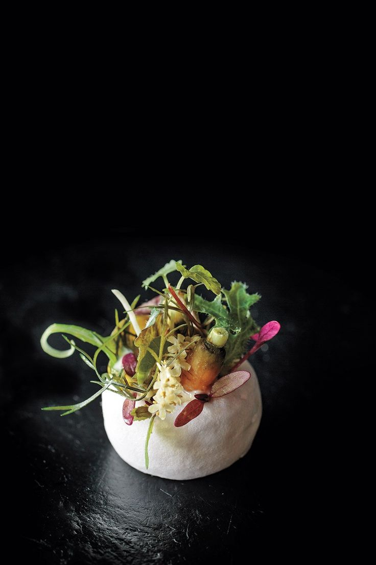 """A look at the fairy-tale food of Atelier Crenn. Served at the end of the savory portion of the tasting menu at Atelier Crenn, this """"salad,"""" a vinegar meringue dressed with greens (instead of the other way around) is """"a bit disorienting,"""" writes Crenn."""