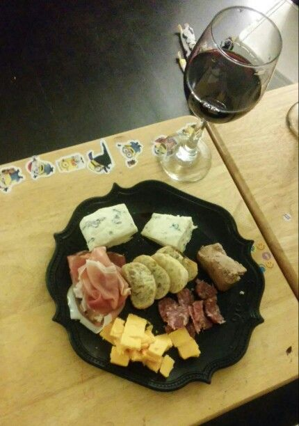 Move over DOC Wine Bar. My homemade charcuterie board.... Ingredients thanks to Trader Joes. Cambozola bleu and aged cheddar cheese...smoked prosciutto, aged salami with truffles and chicken liver paté...baguette and water crackers. Complimented with Trader Joes Grand Reserve Zinfindel.