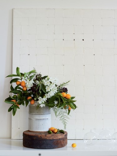 Mix florals with fruit-kumquats with paper whites, dark berries of mature English ivy, and lacy ferns