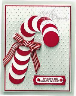 Bastón de caramelo con círculos rojos y blancos