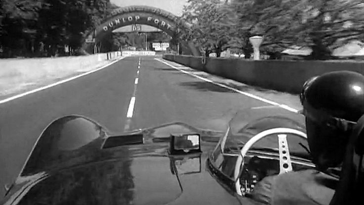 LM 1955 ♦A day before the race, Hawthorn, with his Jaguar mounted with a camera, takes a lap for film-goers later to admire...