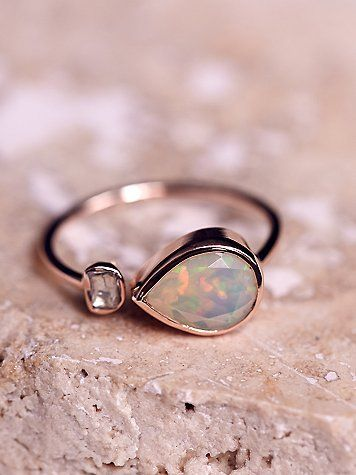 Opal x Rose Cut Diamond Ring   Handmade in France this gorgeous and delicate 9k rose gold ring features a teardrop shaped opal stone with a side rose cut diamond.