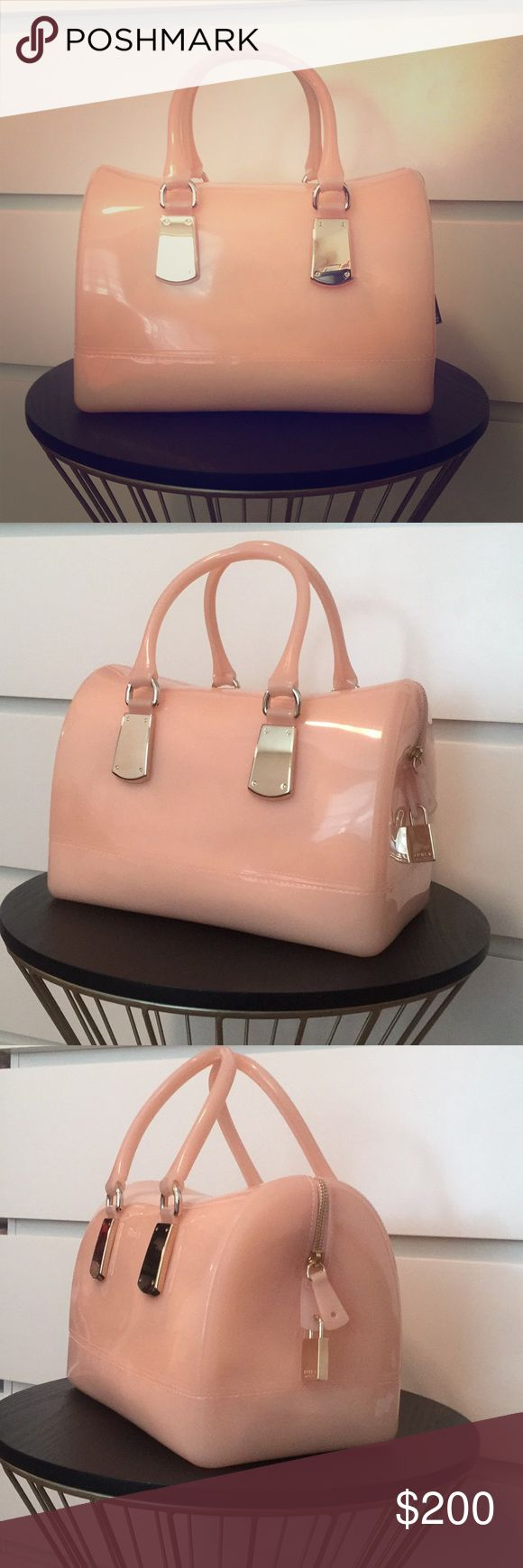 Furla Candy bag Beautiful Furla Candy bag in Magnolia color.   -NWT and dust bag -Material PVC & metal hardware -Made in Italy Furla Bags Satchels
