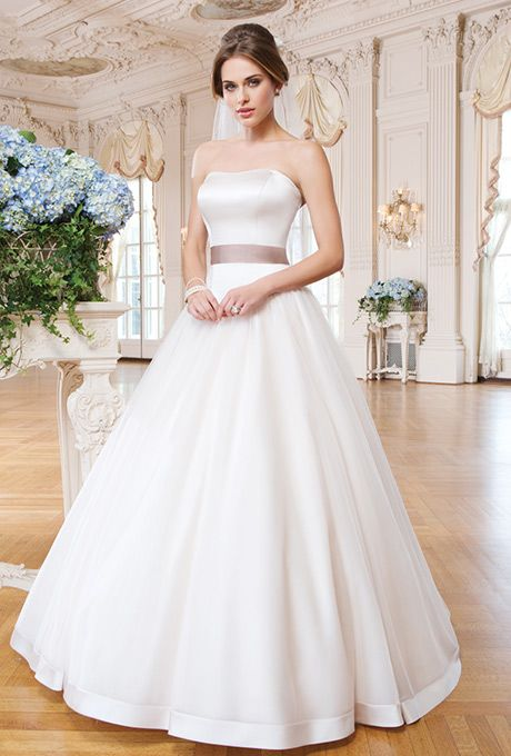 "Brides: Lillian West. Tulle and matte satin ball gown accented with a sweetheart neckline. Satin covered buttons, buttons to end of zipper, 2"" satin hem on skirt."