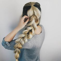 Blonde hair into a pull through pony tail hairstyle for a cute casual look