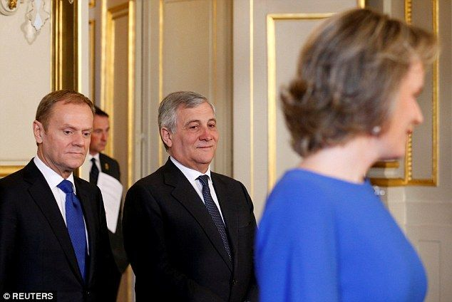 European Council President Donald Tusk and EU Parliament President Antonio Tajani give Queen Mathilde a look over.