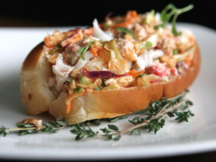 A lobster roll boosted with Sriracha and a kimchi cole slaw is anything but traditional.