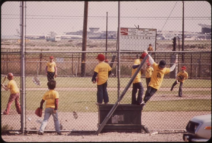 https://flic.kr/p/6Bk9KB | Logan Airport Area. Little League Game on Land Loaned by Massport | Original Caption: Logan Airport Area. Little League Game on Land Loaned by Massport (Massachusetts Port Authority) near Bennington Street East Boston's Main Thoroughfare. Some Local Citizen Leaders Consider This to Be Part of a Public Relations Campaign by Massport on Behalf of Its Continuing Inroads into the Neighborhood, 05/1973  U.S. National Archives' Local Identifier:  412-DA-6798…