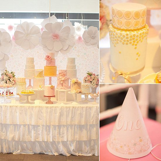 """A Pretty in Pink and Gold First Birthday Party: Sometimes """"pretty"""" is enough of a birthday party theme, as proven by this gorgeous flower-and-cake-filled birthday party thrown by Leanne Ambrogio of Australian event company Sweet Style for 1-year-old Mariette. """"The color palette was soft pinks and blues with a hint of gold, which always look so elegant together,"""" Leanne says. But the stars of this show (beyond the birthday girl, of course) were the nine — yes, nine! — gorgeous birthday cakes…"""