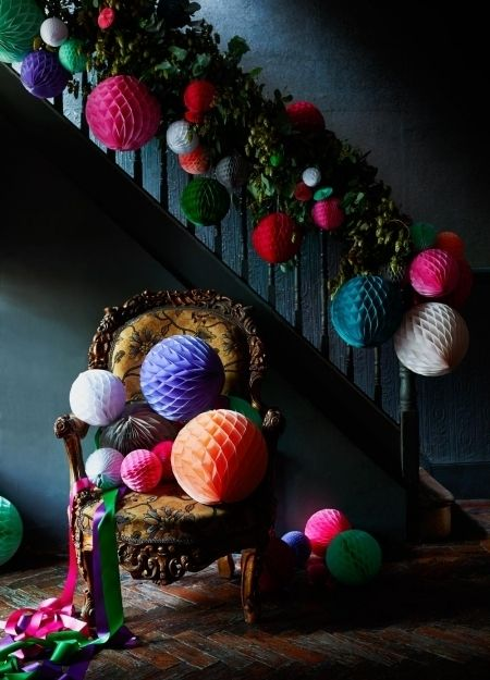 Easy ways to decorate for Christmas Use leaves up the bannisters to create festive impact. Punctuate with paper lanterns and you've got Christmas right there.