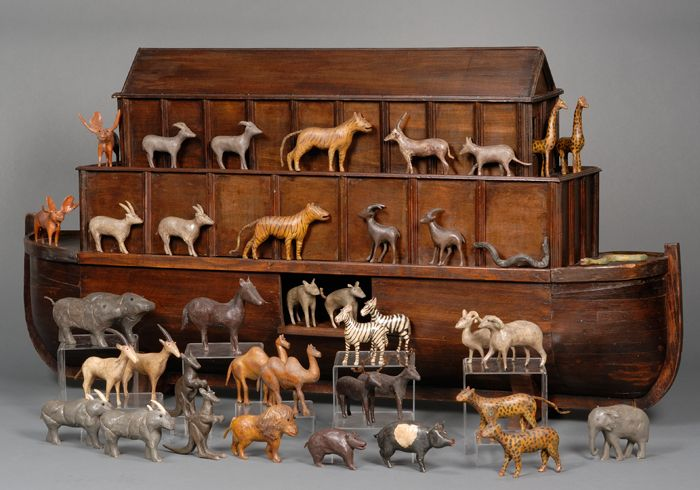 Large Wooden Ark with Carved and Polychrome-painted Wooden Animals, found in Newtown, Connecticut, 20th century, the three-tier vessel with removable top sections and sliding side door, accompanied by forty-one carved and painted animal figures, mounted on a stand