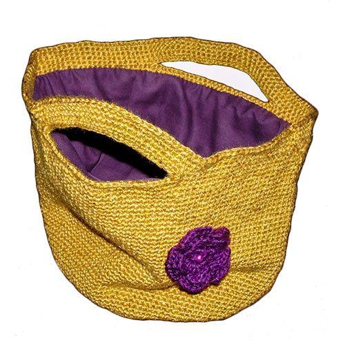 Gele handtas met paarse voering en bloem