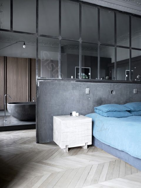 stunning industrial en suite bedroom. concrete, steel, parquet, glass