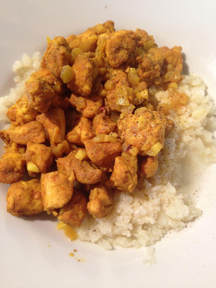 Chicken curry (onion, garlic, ginger, mild curry powder, cumin, salt, chilli) served with cauliflower rice