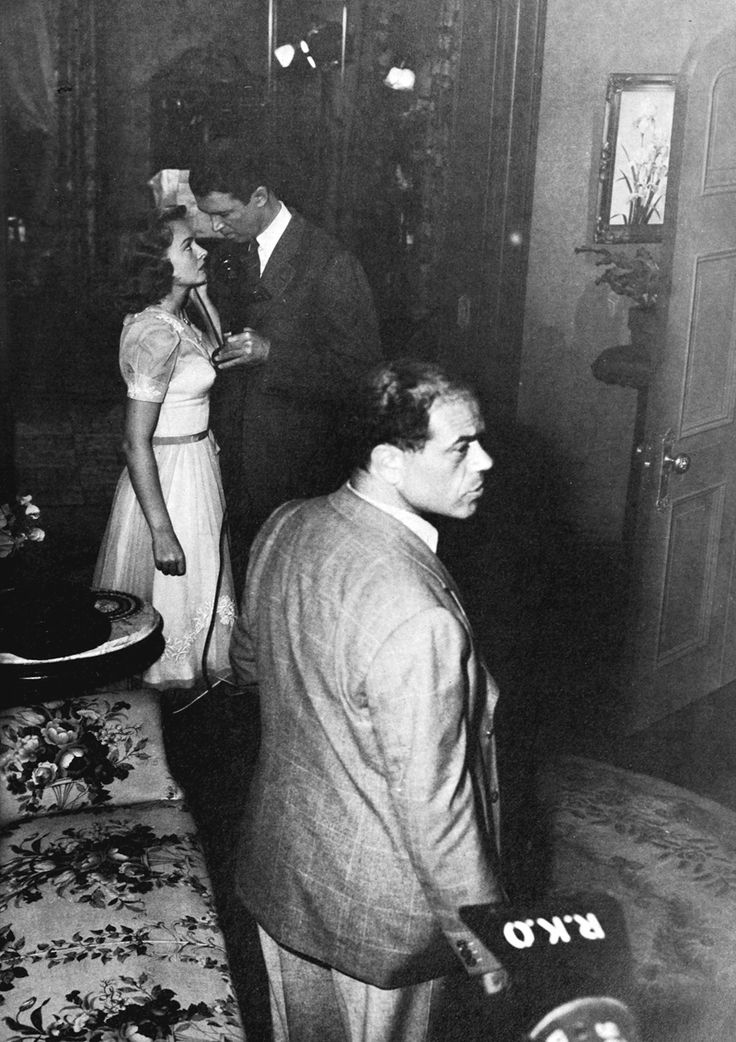 "Director Frank Capra with Jimmy Stewart and Donna Reed on the set of ""It's a Wonderful Life"", 1946."