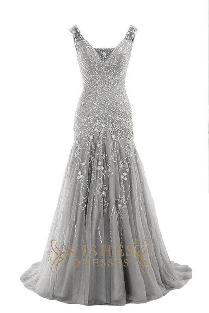 This long dress make of delicate embroidery and handmade beads with v neckline and orhanza skirt.Photographed in silver ,this style is very popular these years.Knee length is also available. Mismatch