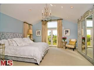 Tori Spelling master bedroom. Obsessed with the blue and tan and the fabric headboard