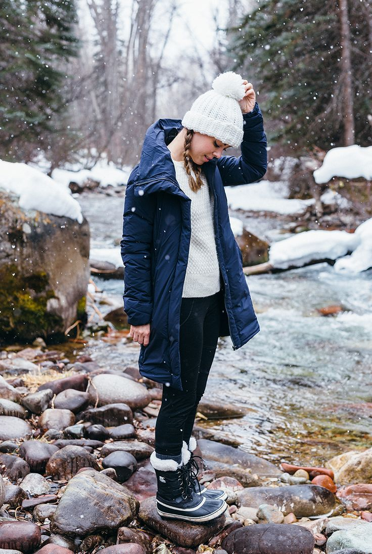 A puffer coat with a dramatic collar is the perfect piece for a snowy adventure.