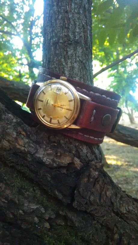 Watch strap cuff featuring an antique Rotary model 42