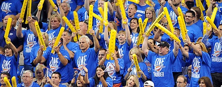 Oklahoma City Thunder fans cheer during the first quarter of game one against the Miami Heat in the 2012 NBA Finals at Chesapeake Energy Arena
