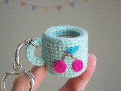 Free crochet pattern for a tiny amigurumi cup by Petits Pixels.