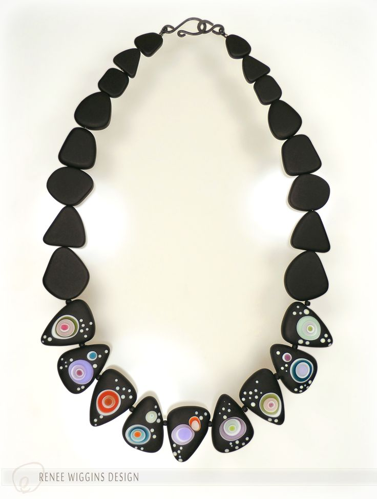 """Renee Wiggins Design. """"Midnight Carnival"""" necklace with handmade lampworked glass beads adorned with pools of luscious color and raised dots, and etched matte. Accompanied with black cultured sea glass beads and handmade hammered and oxidized sterling silver clasp. 6-2016"""