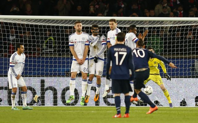 PSG's Zlatan Ibrahimovic, No 10, takes a direct free kick that deflects off Chelsea's John Obi Mikel into the net.