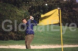 Golf. Out of the bunker. Stock Photo By Rob Walls