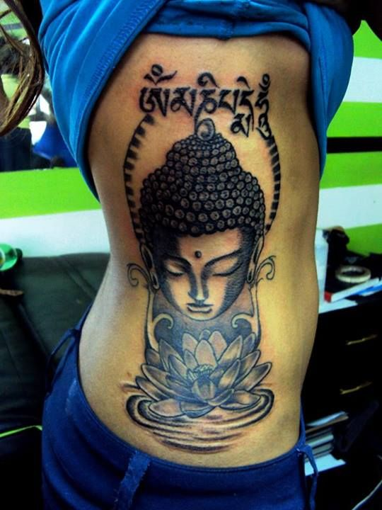 Wayana's side piece, custom made Buddha with Lotus on water and a mantra at the top. :)