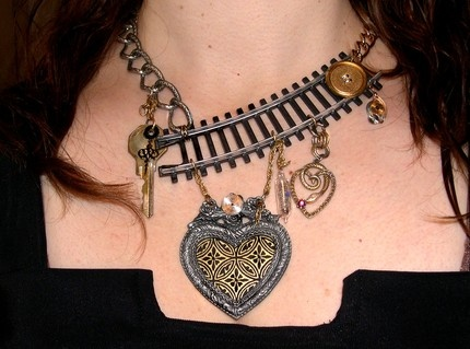 Train necklace -- TOO COOL! I never thought of this, and train tacks are cheap to pick up.