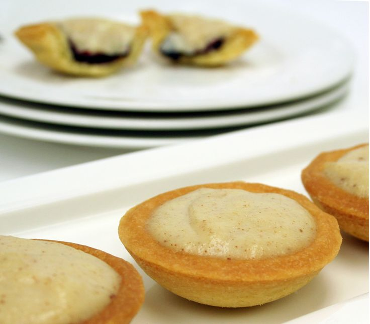 Method Using a standard sweet pastry recipe pin out dough.  Cut out circular shapes using a cutter and place into small tart baking trays.  Pipe 10 grams of Barker's Boysenberry Patisserie Filling into the centre of the tarts.  Bake at 180ºC for approximately 8 to 10 minutes or until golden brown in colour.  While cooling make the Cinnamon Custard. Then pour finished custard on top and leave to set.  Cinnamon Custard 530ml Milk 115g Castor Sugar  Bring to a soft boil then add slurry…