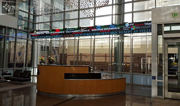 """This custom lobby stock ticker is about 3 feet tall and welcomes visitors to the reception area of a well-known fund company in Denver, Colorado.  Inside a single cabinet are 3 sep32-pixel pixel Tickers each with a different """"stream"""" of data being fed by C-scape's JetStream software.  The display allows for a CNBC type look with NYSE on the top, Nasdaq in the middle, and the bottom ticker to show headline news mixed with welcome messages and announcements."""