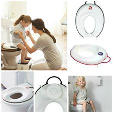 BabyBjorn: Toilet Trainer  Available in white/black, white/red   - The toilet trainer can be adjusted to fit any toilet. When adjusted, it remains firmly on the toilet seat. A rubber strip keeps the toilet trainer from sliding around.  - Ergonomic design helps your child sit correctly, comfortably and securely  - Only needs to be adjusted once, so child can easily put on and remove the toilet trainer on their own  - Easy to clean with running water or a damp cloth
