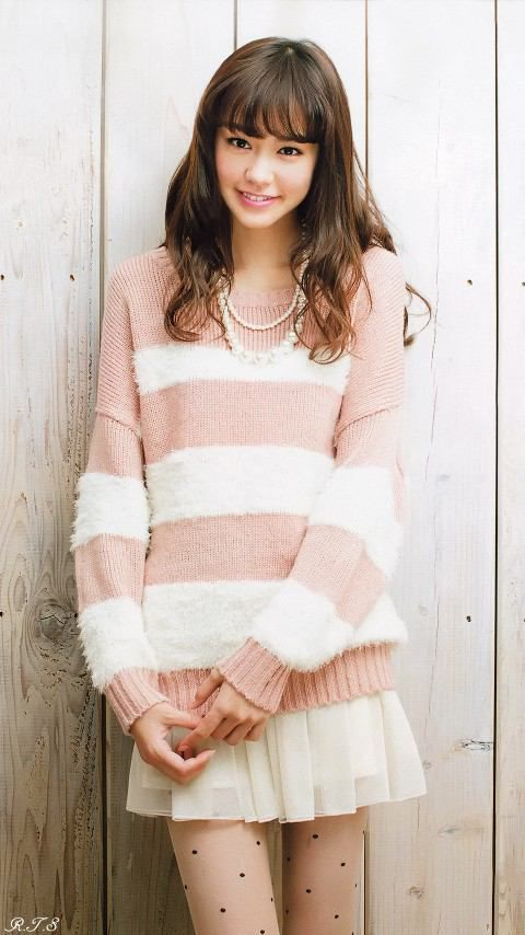 oversized striped sweater <3 I really like how the boldness of the stripes on the sweater contrast well with the delicate polka dots on the tights.