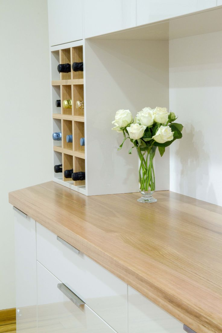 Small contemporary kitchen with bar buffet. Stunning timber benchtop. Wine storage. www.thekitchendesigncentre.com.au