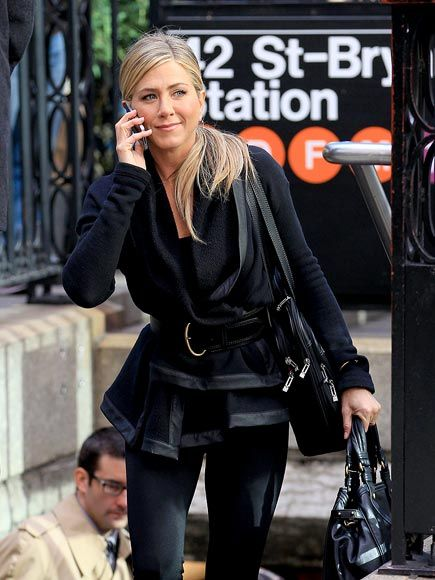 Love how Jennifer belted her 'Wayne' hooded sweatshirt w/faux leather trim.  Her hair is fantastic too....