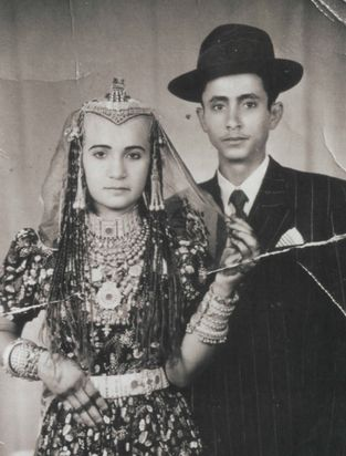 A Habbani Jewish couple, married in Israel after their 'aliya, mid-20th century. Note the traditional henna and jewelry paired with the Western clothing.