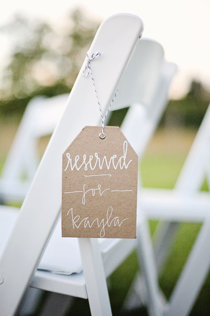 custom made signs for the bride + grooms family @Colleen Kerns     {Hannah from glitter & garland shares her wedding day} glitterandgarland.com Photo: Colleen Kerns- http://www.colleenameliaphotography.com