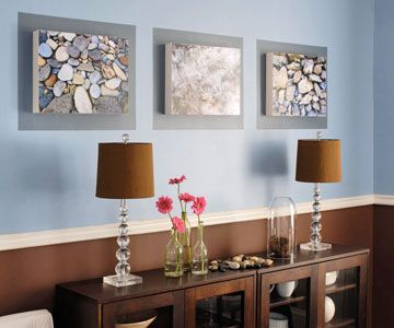 Mount nature shots on fiberboard then attach to wood boxes to give a 3-D effect.  Silvery rectangles painted on the wall frame the 3-D art.