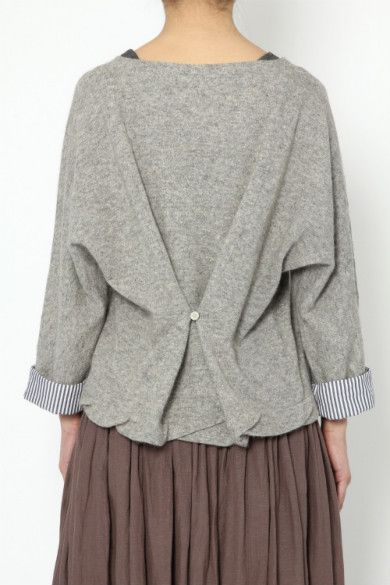 DIY Inspo: oversized sweater with nipped waist, thanks to button and loop.  Would be adorable in a nice spring pastel (yellow), short t-shirt sleeves.