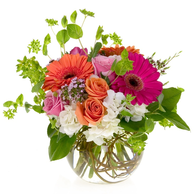Bright and happy gerbera daisies in an armature filled bubble bowl