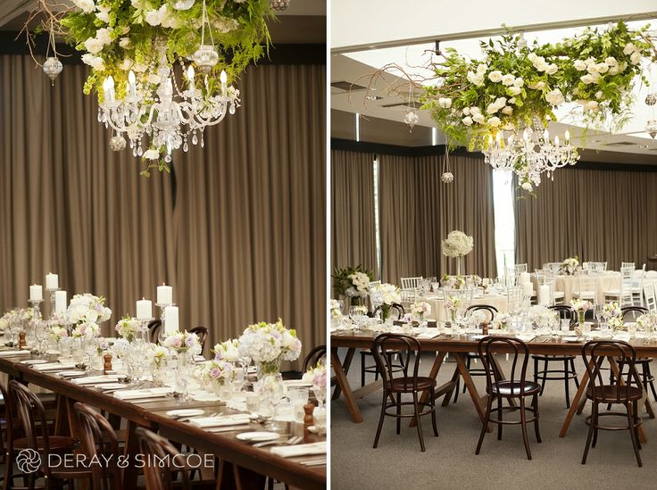 Hanging tree branch with white roses and a crystal chandelier. Wooden decor. Modern wedding reception styling, ideas and inspiration. Wedding Reception at The State Reception Centre Kings Park, Perth Western Australia  Photography by DeRay & Simcoe