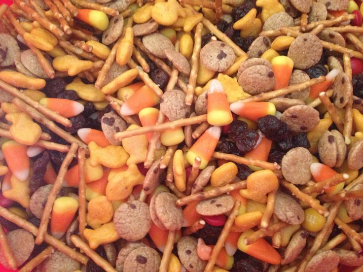 Fall trail mix I use fall colored M &M's, gold fish cheese crackers, candy corn, peanuts, pretzel sticks for witches brooms, raisins as bat poop, and cookie crisp cereal. Mix together and you have a fun fall treat.