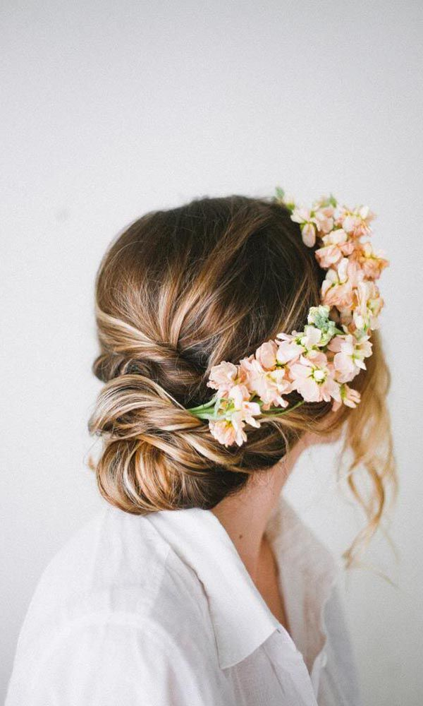 Rustic updo wedding hairstyle - medium long hair, floral, elegant. See more: http://www.weddingforward.com/romantic-bridal-updos-wedding-hairstyles/ #weddinghairstyles #bridalhairstyles