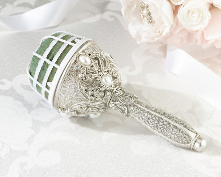 """The regal elegance bouquet holder is a dazzling way to show off any floral arrangement. Features faux pearl and rhinestone accents with an antique finish. It measures 7.5"""" in total length for easy car"""