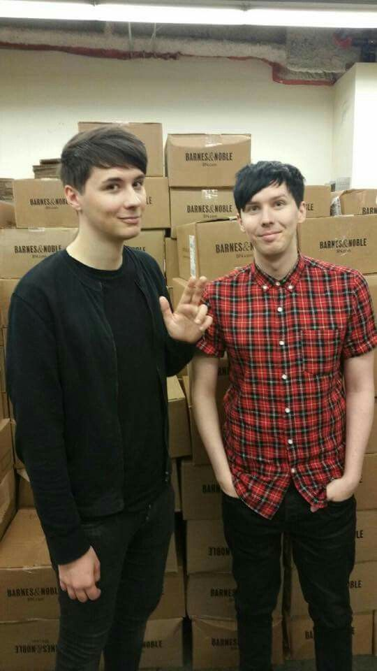 Dan and phil in front of boxes of full of their new book! Go buy it guys…
