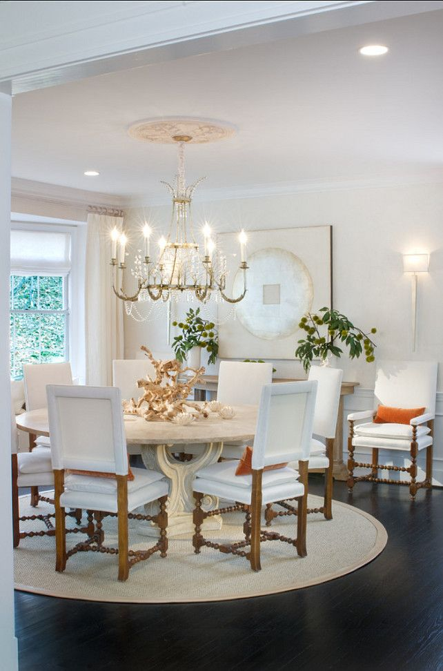 Traditional Dining Room With White Decor Large Wall Art Piece And Ebony Hardwood Floors