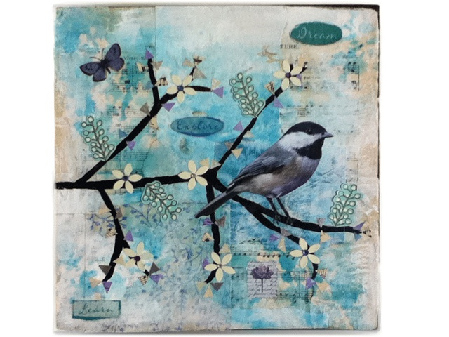 mixed media painting using vintage sheet music, bird from a calendar, stickers, and paint